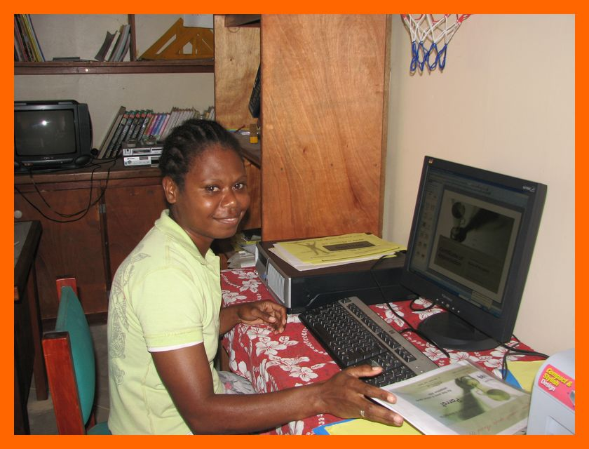 pelis school administrator learning how to use the computer purchased by the butterfly trust
