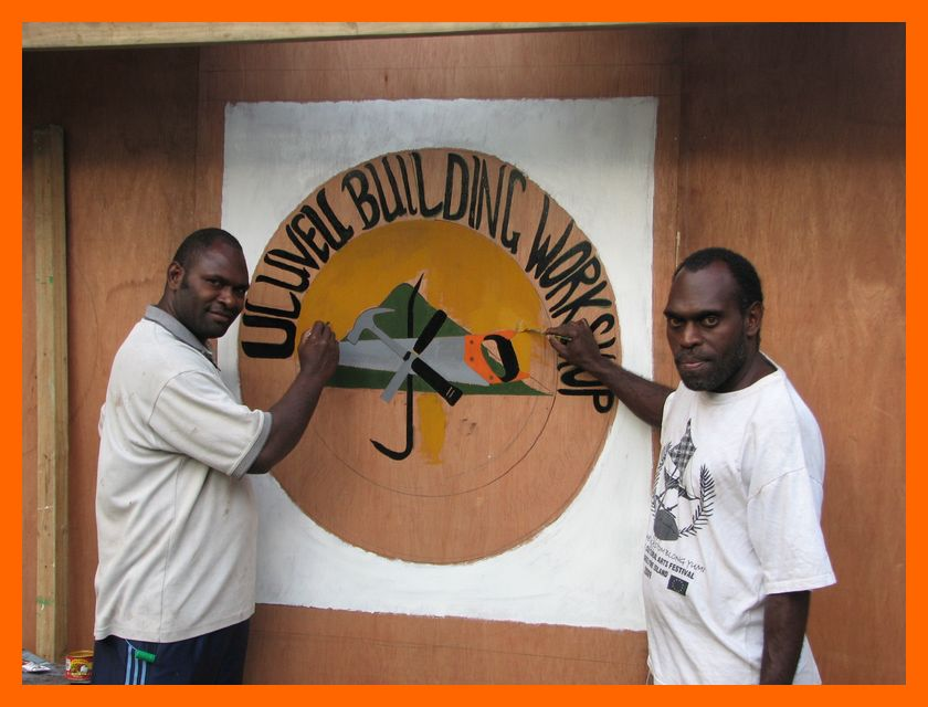 showing off the new sign for the uliveo builders workshop