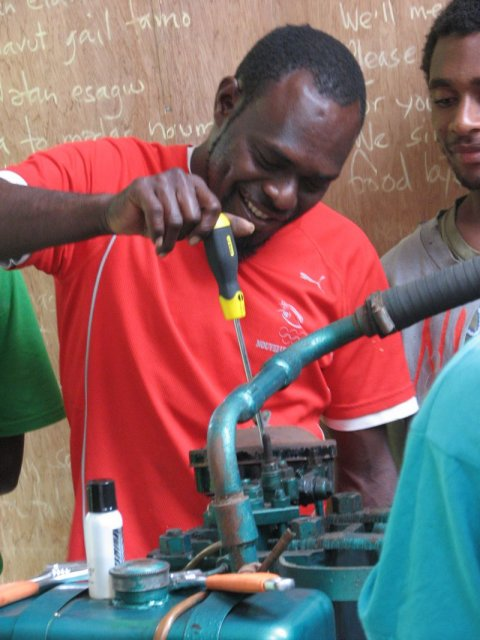 Tasili undoing a bolt on the Listeroid
