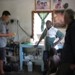 Dr Graham Evans assisting the Sangalai Clinic with Charlie Siniu and Dave